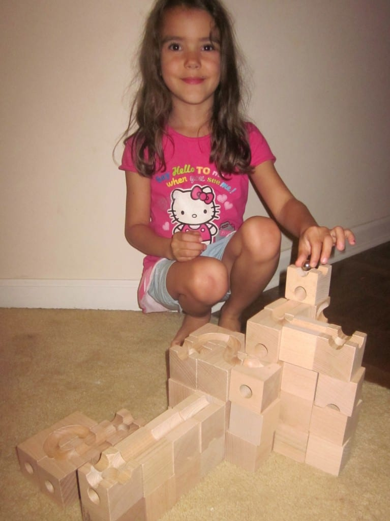 6 year old playing with Cuboro Standard Wooden Marble Run