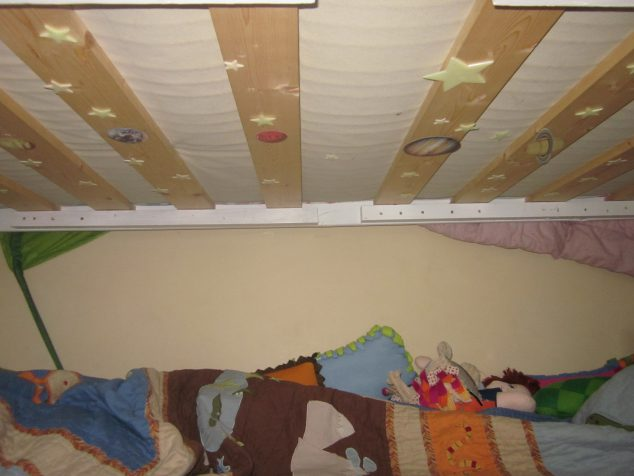 Glow in the dark stars and planets on my son's bunk bed.