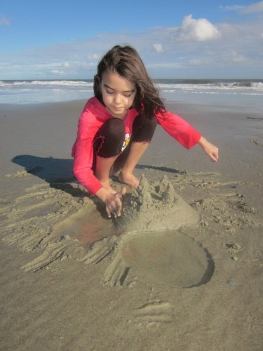Child building sand castle on Tybee Island beach