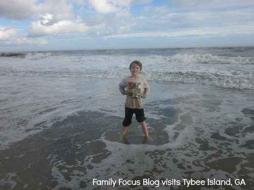 Child plays in waves on Tybee Island beach