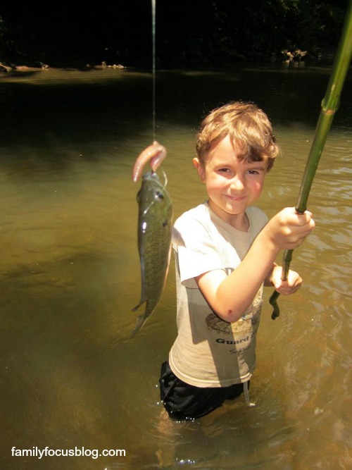 children enjoy nature- kid fishing