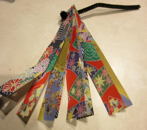 place paper strips onto wire